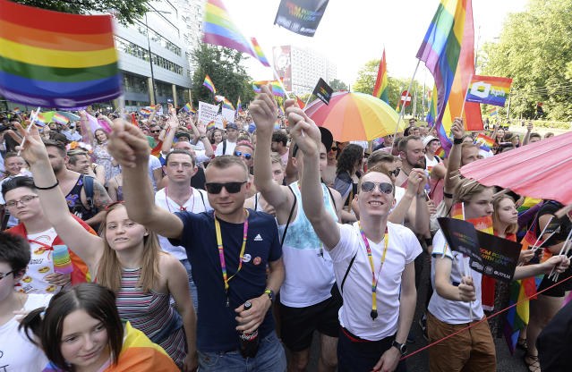 <p>People take part in a Gay Pride parade in Warsaw, Poland, Saturday, June 9, 2018. The pride celebrations come as LGBT activists say a conservative turn in Poland is only motivating them to fight harder for their rights, even though their hopes of seeing same-sex marriage legalized has no chance now in the country. (Photo: Czarek Sokolowski/AP) </p>
