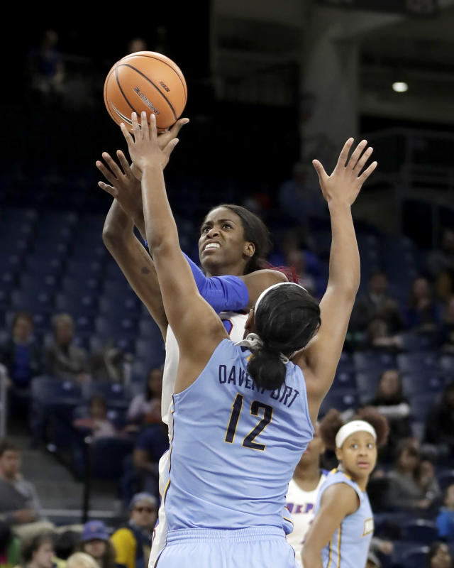 DePaul's Chante Stonewall shoots over Marquettes' Erika Davenport (12) during the first half of an NCAA college basketball game in the championship of the Big East conference tournament, Tuesday, March 6, 2018, in Chicago. (AP Photo/Charles Rex Arbogast)