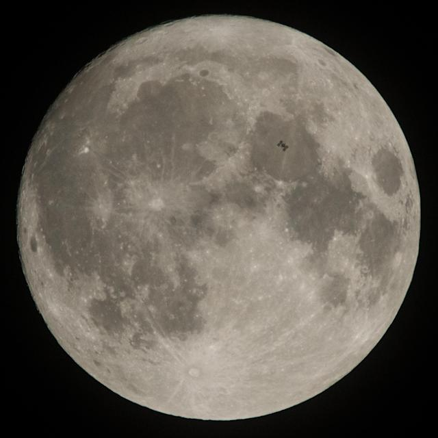 <p>The International Space Station, with a crew of six onboard, is seen in silhouette as it transits the Moon at roughly five miles per second, Saturday, Dec. 2, 2017, in Manchester Township, York County, Pa. Onboard are NASA astronauts Joe Acaba, Mark Vande Hei, and Randy Bresnik; Russian cosmonauts Alexander Misurkin and Sergey Ryanzansky; and ESA astronaut Paolo Nespoli. (Photo: NASA/Joel Kowsky) </p>