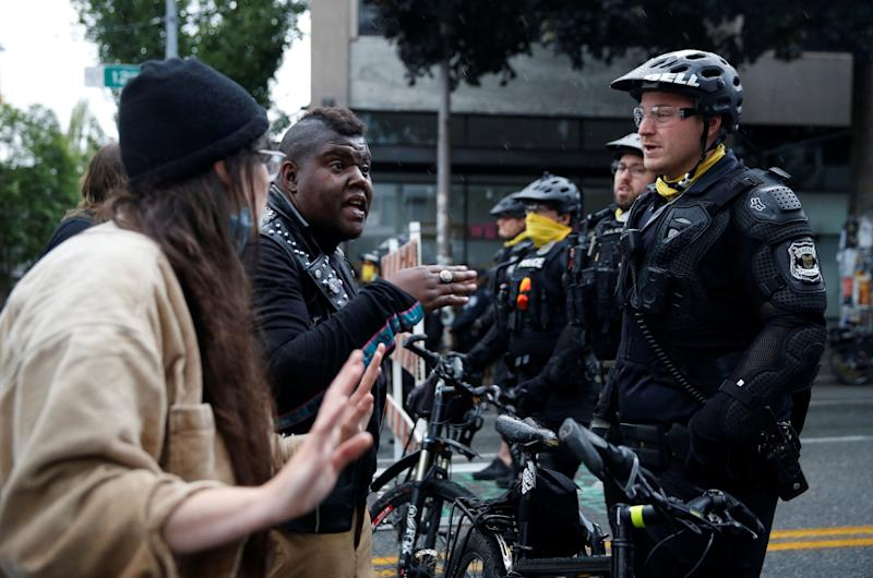 Police officers working to retake the Capitol Hill occupied protest area in Seattle last week (Reuters)