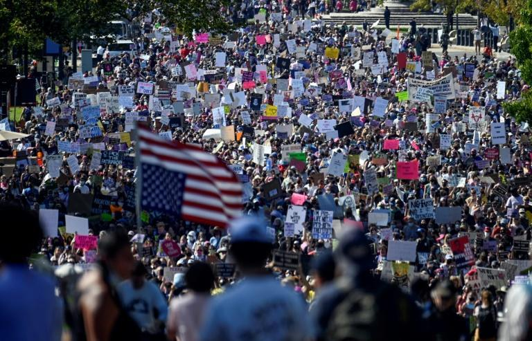 """""""Women are humans, we are full humans, and we need to be treated like full humans,"""" one protester said in Washington (AFP/ANDREW CABALLERO-REYNOLDS)"""