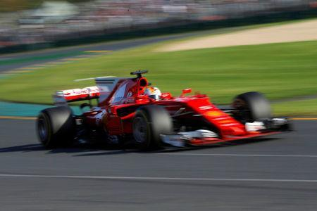 Formula One - F1 - Australian Grand Prix - Melbourne, Australia - 26/03/2017 - Ferrari driver Sebastian Vettel of Germany drives during the Australian Grand Prix. REUTERS/Jason Reed