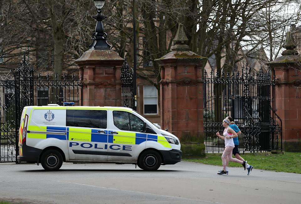 Police patrol Kevingrove Park in Glasgow as the UK continues in lockdown to help curb the spread of the coronavirus. (Photo by Andrew Milligan/PA Images via Getty Images)