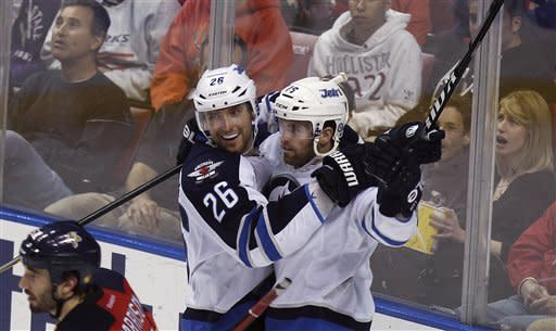Winnipeg Jets' Blake Wheeler (26) and Andrew Ladd celebrate after Ladd scored in the third period of an NHL hockey game against the Florida Panthers in Sunrise, Fla., Tuesday, April 3, 2012. The Jets won 5-4 in overtime. (AP Photo/J Pat Carter)