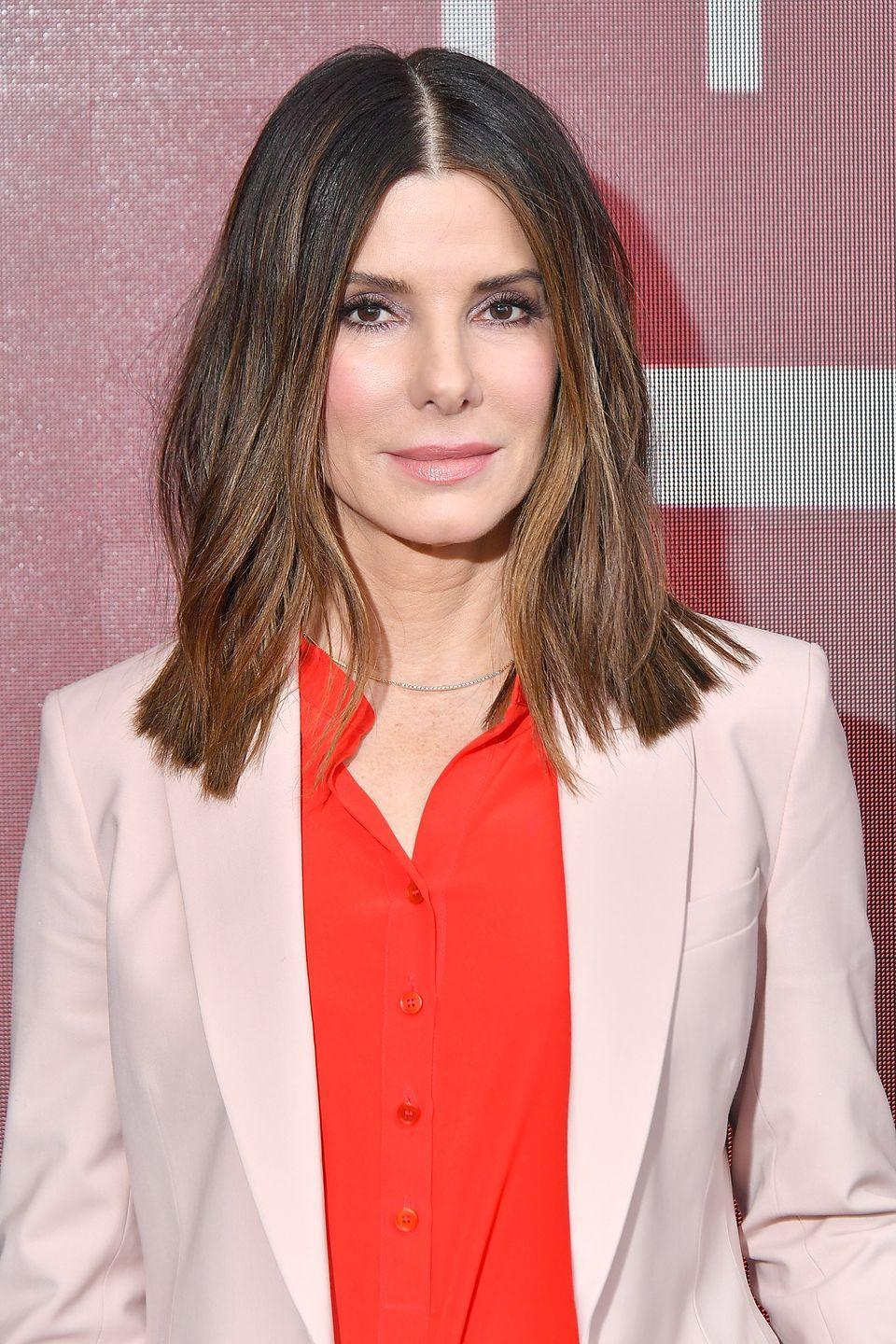 """<p>Sandra Bullock mimicked her character Leigh Anne Tuohy from the movie <em>The Blind Side</em> by <a href=""""http://usatoday30.usatoday.com/life/people/2010-04-29-bullock29_CV_N.htm"""" rel=""""nofollow noopener"""" target=""""_blank"""" data-ylk=""""slk:adopting a son"""" class=""""link rapid-noclick-resp"""">adopting a son</a>, Louis, in January 2010. Five years later, she revealed that she'd <a href=""""http://www.eonline.com/de/news/720501/sandra-bullock-reveals-how-she-kept-daughter-laila-s-adoption-secret-it-felt-very-much-like-witness-protection"""" rel=""""nofollow noopener"""" target=""""_blank"""" data-ylk=""""slk:also adopted a little girl named Laila"""" class=""""link rapid-noclick-resp"""">also adopted a little girl named Laila</a>.</p>"""