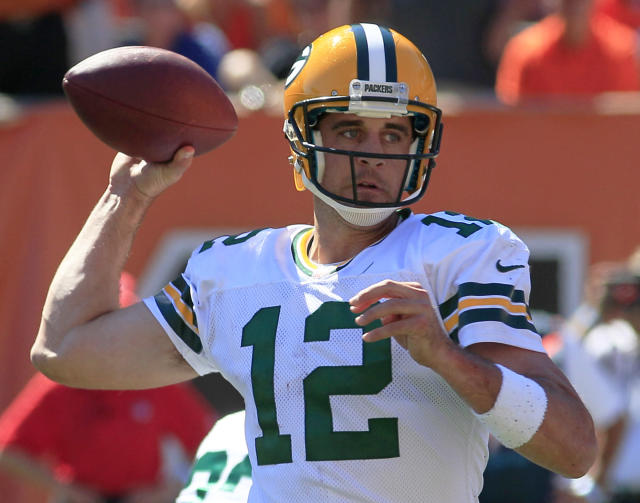 Green Bay Packers quarterback Aaron Rodgers passes against the Cincinnati Bengals in the first half of an NFL football game, Sunday, Sept. 22, 2013, in Cincinnati. (AP Photo/Tom Uhlman)