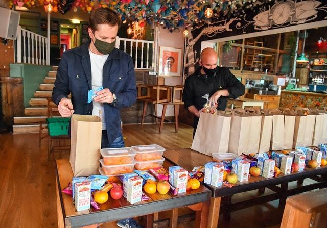 Andy Hope-Johnstone (left) and James Koch prepare free packed lunch bags for delivery at the Gallimaufry pub in Bristol