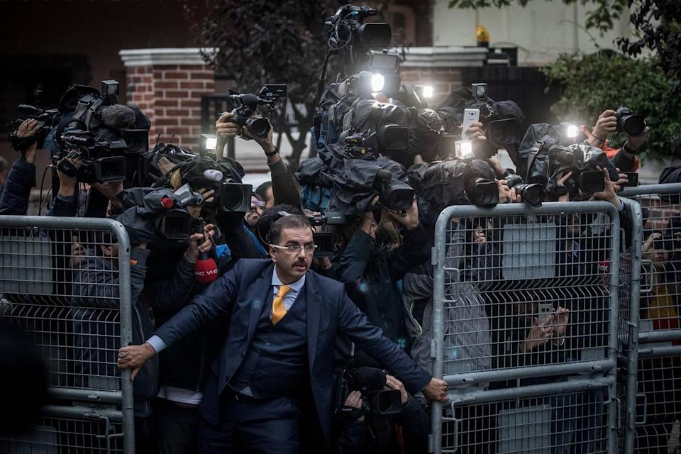 <p>An unidentified man tries to hold back the press on 15 October, as Saudi investigators arrive at the Saudi Arabian Consulate in Istanbul, Turkey, amid a growing international backlash to the disappearance of journalist Jamal Khashoggi. (Chris McGrath/Getty) </p>