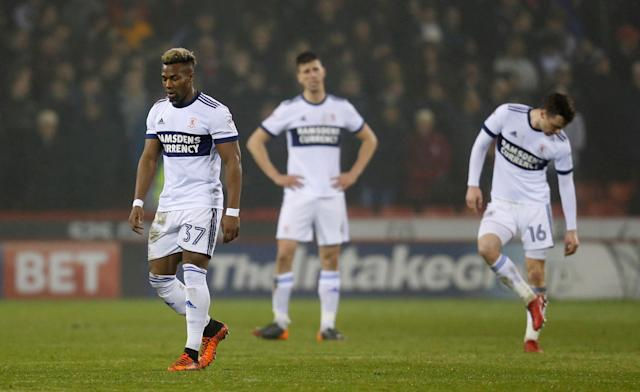 "Soccer Football - Championship - Sheffield United vs Middlesbrough - Bramall Lane, Sheffield, Britain - April 10, 2018 Middlesbrough's Adama Traore, Daniel Ayala and Jonathan Howson look dejected after conceding the second goal Action Images/Ed Sykes EDITORIAL USE ONLY. No use with unauthorized audio, video, data, fixture lists, club/league logos or ""live"" services. Online in-match use limited to 75 images, no video emulation. No use in betting, games or single club/league/player publications. Please contact your account representative for further details."