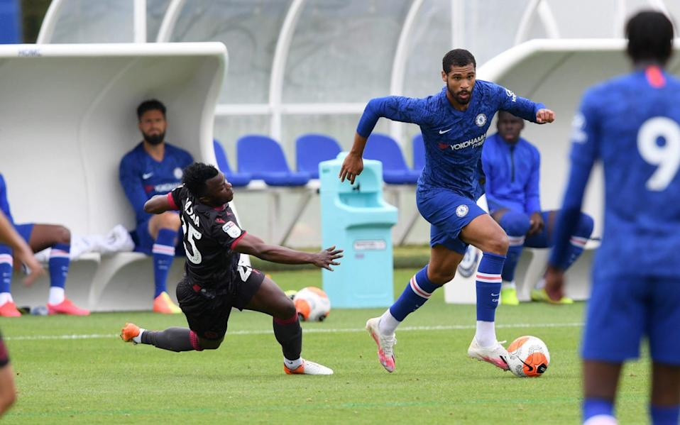 Ruben Loftus-Cheek of Chelsea and Ayub Timbe Masika of Reading battle for the ball - GETTY IMAGES