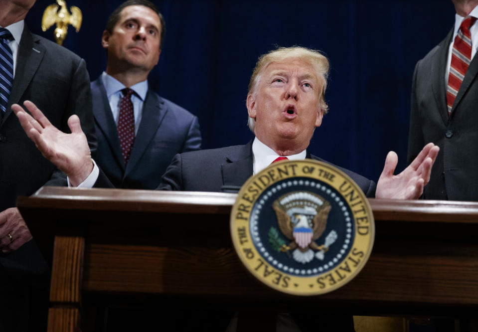 """FILE - In this Oct. 19, 2018 file photo, President Donald Trump speaks during a ceremony to sign a """"Presidential Memorandum Promoting the Reliable Supply and Delivery of Water in the West,"""" Friday, Oct. 19, 2018, in Scottsdale, Ariz.. Standing behind the president is Rep. Devin Nunes, R-Calif. Trump is set to present one of the nation's highest civilian honors to Nunes(AP Photo/Carolyn Kaster)"""