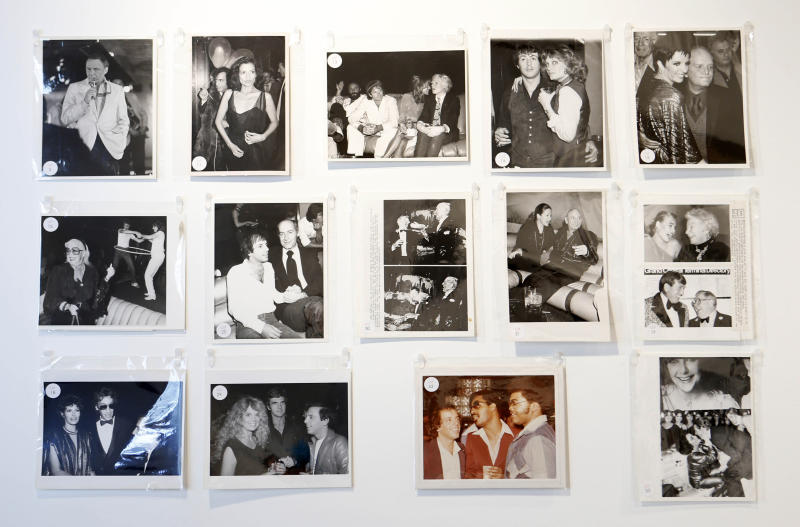 This Jan. 16, 2013 photo shows mounted photographs taken at Studio 54 on display in West Palm Beach, Fla. Memorabilia from the famed 1970s club is hitting the auction block in Florida. The private collection of co-founder Steve Rubell is being sold Saturday in West Palm Beach. (AP Photo/Alan Diaz)