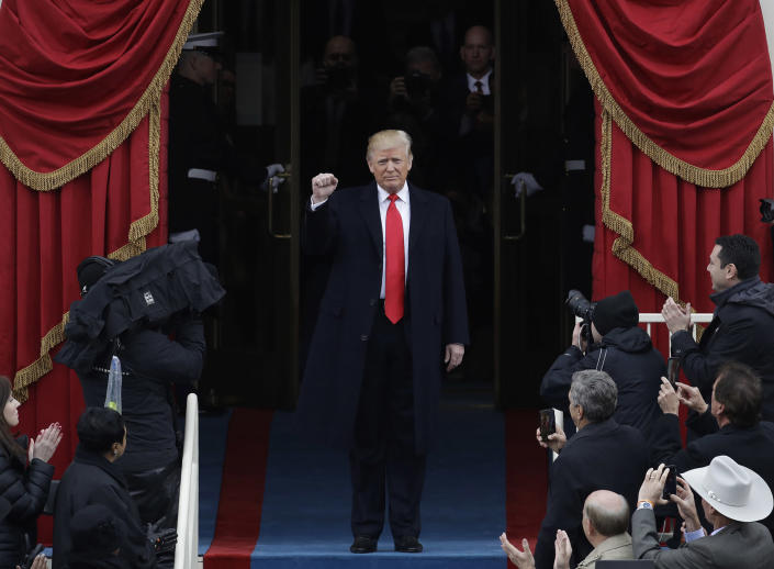 <p>President-elect Donald Trump pumps his fist as he arrives for his Presidential Inauguration at the U.S. Capitol in Washington, Friday, Jan. 20, 2017. (Photo: Patrick Semansky/AP) </p>