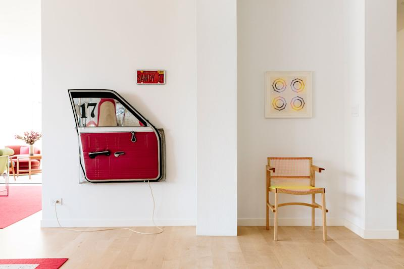 Another inherited treasure from Jessica's grandparents: a car-door work by Edward Kienholz from 1972. To the right it is a 1968 piece by Judy Chicago, and the tennis racket armchair is by Julian Hoeber, an L.A.-based artist.