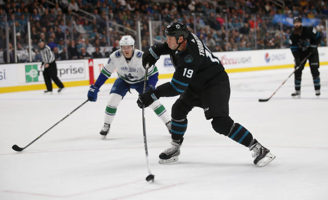 San Jose Sharks' Joe Thornton (19) shoots the puck during the first period of the team's NHL hockey game against the Vancouver Canucks in San Jose, Calif., Friday, Nov. 23, 2018. (AP Photo/Josie Lepe)