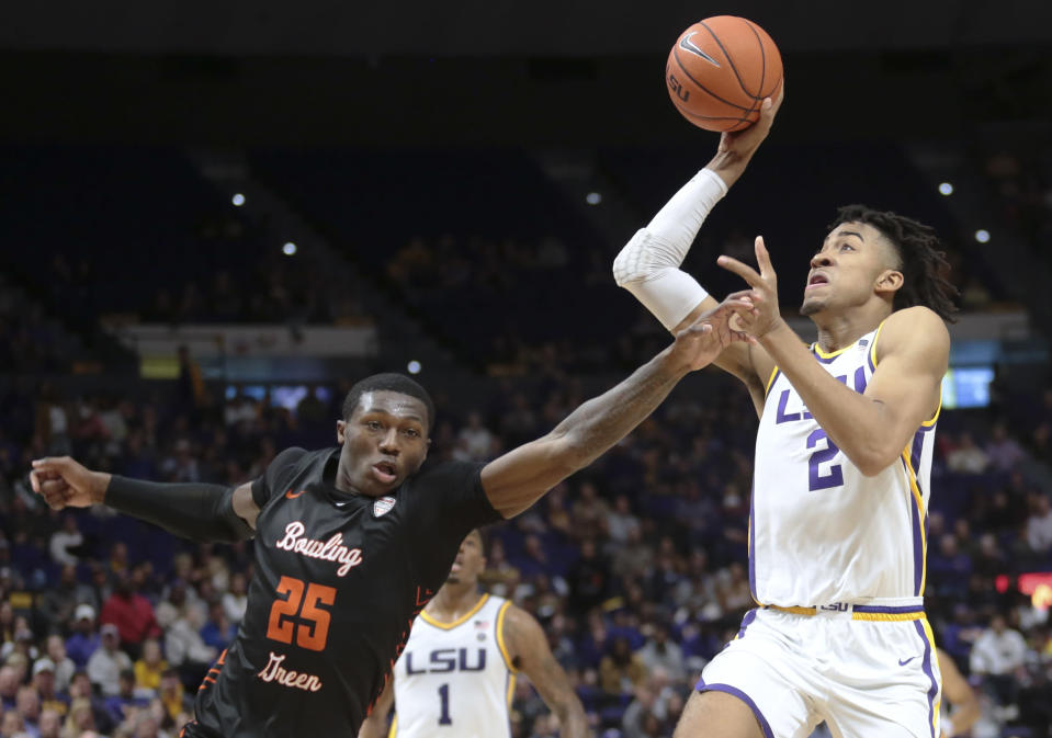 LSU forward Trendon Watford (2) drives to the basket as Bowling Green guard Daeqwon Plowden (25) defends during first half action of an NCAA college basketball game in Baton Rouge, La. Friday, Nov. 8, 2019. (AP Photo/Brett Duke)