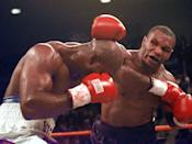 <p>Mike Tyson and Evander Holyfield exchange punches during their WBA Heavyweight match Saturday, June 28, 1997, at the MGM Grand in Las Vegas. The fight was stopped after Tyson bit Holyfield on each ear during the third round. Tyson was disqualified and Holyfield retained his title. (AP Photo/Lenny Ignelzi) </p>