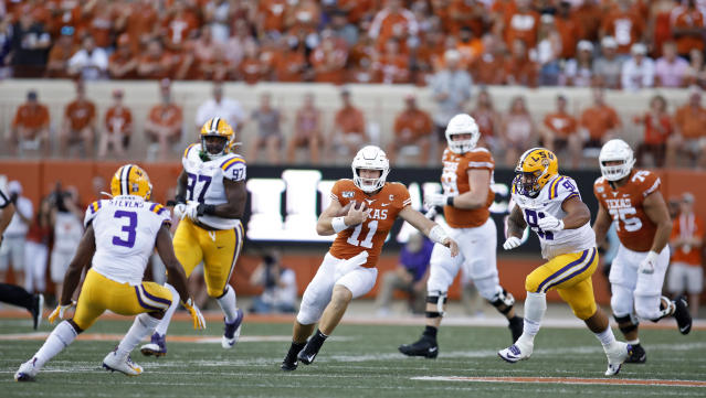 Texas Longhorns quarterback Sam Ehlinger #11 looks for running room between LSU Tigers defenders Saturday Sept. 7, 2019 at Darrell K Royal-Texas Memorial Stadium in Austin, Tx. ( Photo by Edward A. Ornelas )