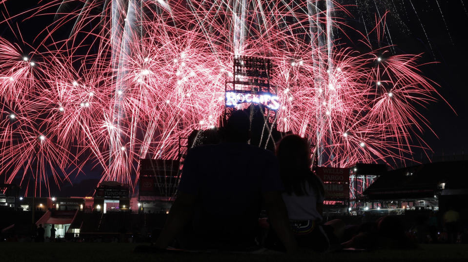 FILE - In this July 3, 2019, file photo, fireworks explode over Coors Field after a baseball game to mark the Fourth of July holiday in Denver. With fewer professional celebrations on July 4, 2020 due to the coronavirus, many Americans are bound to shoot off fireworks in backyards and at block parties. And they already are: Sales have been booming. (AP Photo/David Zalubowski, File)