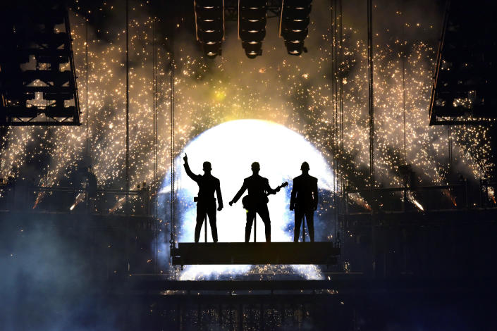 """Nick Jonas, from left, Kevin Jonas, and Joe Jonas, of the Jonas Brothers, perform during their """"Happiness Begins Tour"""" in Chicago on Sept. 19, 2019. (Photo By Rob Grabowski/Invision/AP)"""