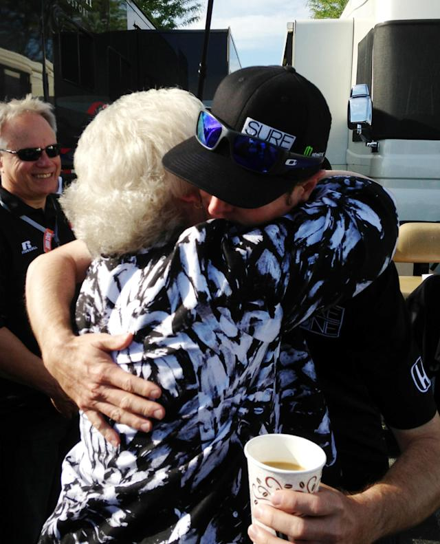 Kurt Busch get a hug from his mother Gaye Busch as she arrived at his motorhome at the Indianapolis Motor Speedway before the start of the 98th running of the Indianapolis 500 IndyCar auto race in Indianapolis, Sunday, May 25, 2014. Bust will attempt to drive both the Indianapolis 500 and the Coke-Cola 600 in Charlotte. (AP Photo/Dan Gelston)