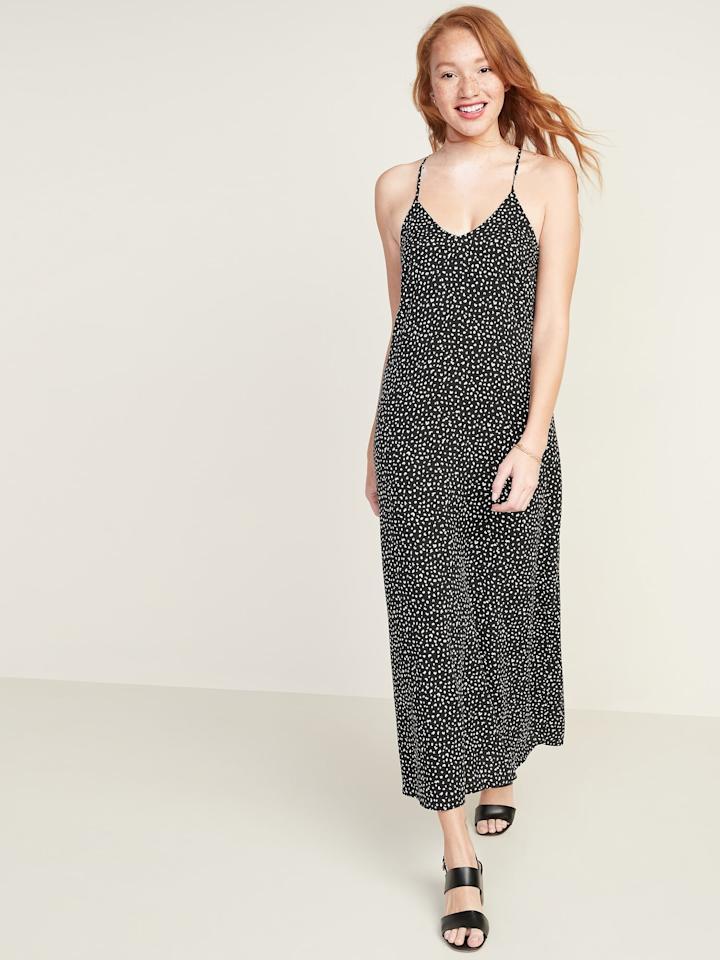 """<p>This <a href=""""https://www.popsugar.com/buy/Sleeveless-V-Neck-Maxi-Shift-Dress-567226?p_name=Sleeveless%20V-Neck%20Maxi%20Shift%20Dress&retailer=oldnavy.gap.com&pid=567226&price=18&evar1=fab%3Aus&evar9=47507705&evar98=https%3A%2F%2Fwww.popsugar.com%2Ffashion%2Fphoto-gallery%2F47507705%2Fimage%2F47507745%2FSleeveless-V-Neck-Maxi-Shift-Dress&list1=shopping%2Cold%20navy%2Cdresses&prop13=mobile&pdata=1"""" rel=""""nofollow"""" data-shoppable-link=""""1"""" target=""""_blank"""" class=""""ga-track"""" data-ga-category=""""Related"""" data-ga-label=""""https://oldnavy.gap.com/browse/product.do?pid=551787022#pdp-page-content"""" data-ga-action=""""In-Line Links"""">Sleeveless V-Neck Maxi Shift Dress </a> ($18) is definitely super popular right now. I've seen a number of people wearing it on Instagram, and I can't wait to get my hands on it. It has adjustable spaghetti straps crossed in back, so you can fit it to your liking. I'll probably wear mine over a white T-shirt and low white sneakers for now.</p>"""
