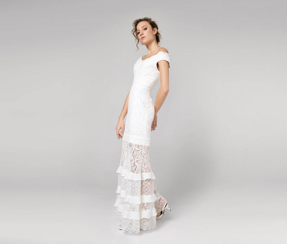 "<p>The Charlotte Dress, $699, <a href=""https://www.fameandpartners.com/dresses/dress-the-kensie-1301?color=ivory"" rel=""nofollow noopener"" target=""_blank"" data-ylk=""slk:fameandpartners.com"" class=""link rapid-noclick-resp"">fameandpartners.com</a> </p>"