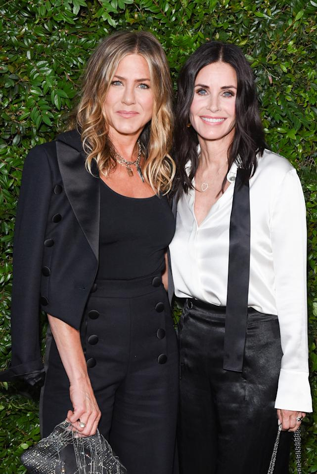 <p>The pair reunited for a high-fashion dinner in Malibu, both wearing chic trouser ensembles. <em>[Photo: Getty]</em> </p>