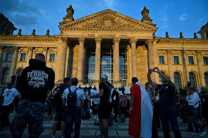 In Berlin, thousands protested against coronavirus restrictions but police later stopped the rally because many were not respecting social distancing measures