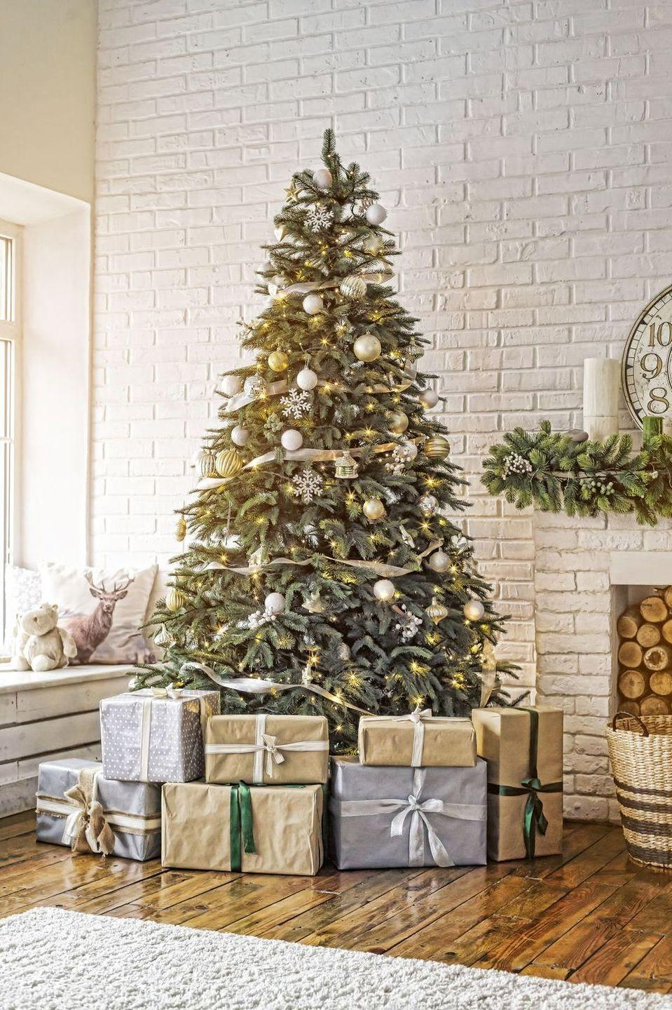 <p>Silver and gold remain the stars of this festive setup—an appropriate palette to match the home's modern feel. </p>