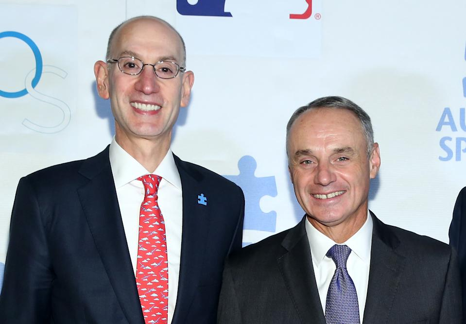 NBA commissioner Adam Silver (left) could learn from his MLB counterpart, Rob Manfred. (Cindy Ord/Getty Images)