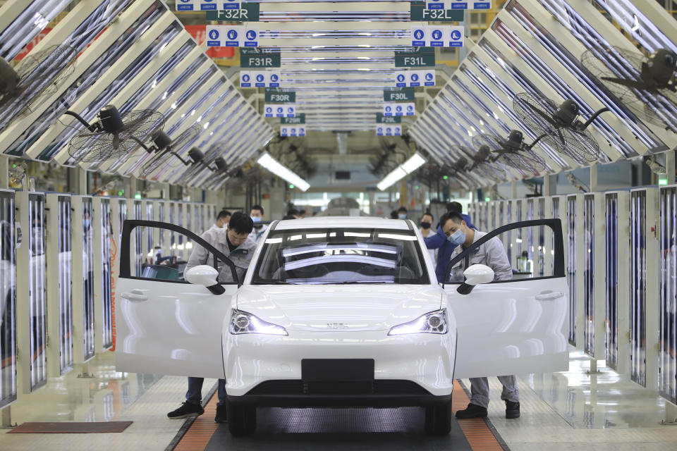JIAXING, CHINA - FEBRUARY 19: Employees work on the assembly line of Neta electric car at a factory of Hozon New Energy Automobile Co., Ltd on February 19, 2021 in Jiaxing, Zhejiang Province of China. (Photo by Cheng Jie/VCG via Getty Images)