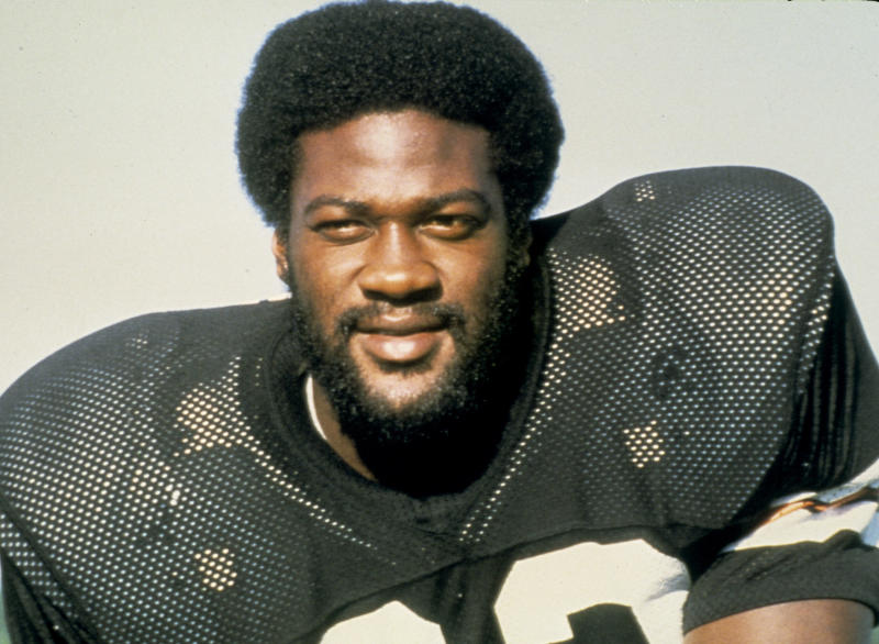"""This handout provided by NFL photos shows Cincinnati Bengals running back David Lee """"Deacon"""" Turner in 1979.  After at least two dozen run-ins with the law, Turner, 56, was shot and killed in front of a convenience store Sunday, July 10, 2011 in Bakersfield, Calif.,  by a Kern County deputy after he allegedly hit an officer with a bag holding two cans of beer. As a student-athlete, Turner thrived, shredding defenses at Shafter High School, Bakersfield College and San Diego State University. But as an adult, after playing in the NFL from 1978 to 1980, he had trouble finding his place in civilian life.  (AP Photo/NFL Photos)"""