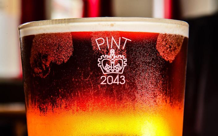 A pint glass etched with the Crown stamp rather than the European CE marking - PA images
