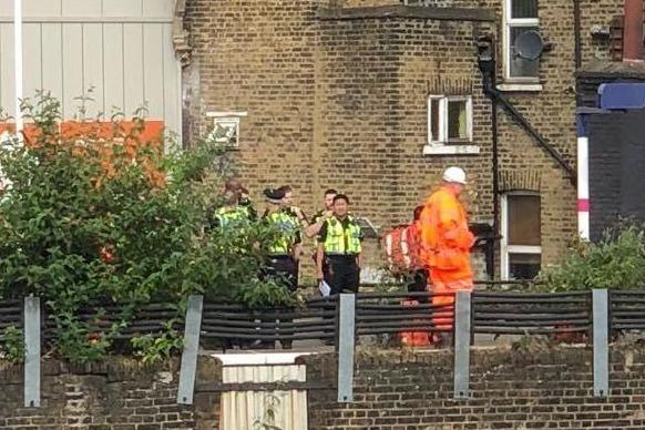 Police and Network Rail engineers at the scene in Loughborough Junction, near Brixton, where the bodies of three people were found on the tracks (Barney Davis)