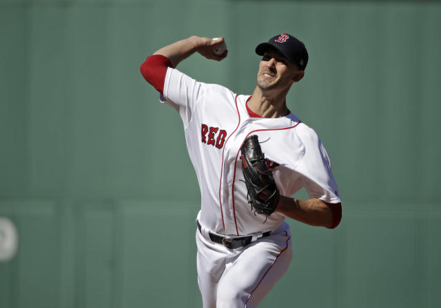 Boston Red Sox starting pitcher Rick Porcello delivers to the Texas Rangers in the first inning of a baseball game at Fenway Park, Wednesday, June 12, 2019, in Boston. (AP Photo/Elise Amendola)
