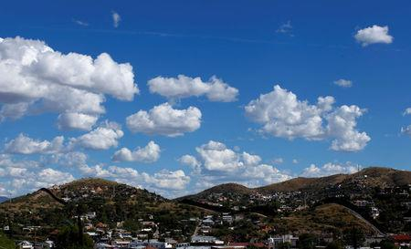 Clouds float above the border towns of Nogales, Mexico and Nogales, Arizona, United States, October 9, 2016. REUTERS/Mike Blake