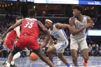 Memphis' Precious Achiuwa (55) drives the ball past Illinois-Chicago's Travell Washington (35) during the second half of an NCAA college basketball game, Friday, Nov. 8, 2019, in Memphis, Tenn. (AP Photo/Karen Pulfer Focht)
