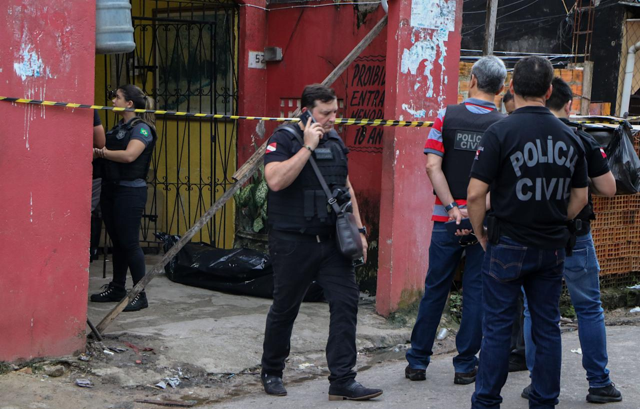 Police officers are seen outside a bar after a shooting, in Belem, Para state, Brazil on May 19, 2019. (Photo: Claudio Pinheiro/AFP/Getty Images)