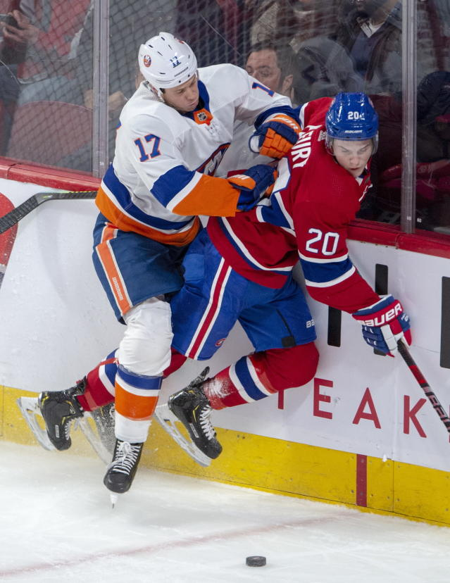 New York Islanders center Josh Bailey (12) checks Montreal Canadiens defenceman Cale Fleury (20) into the boards during first period NHL hockey action Tuesday, Dec. 3, 2019 in Montreal. (Ryan Remiorz/The Canadian Press via AP)