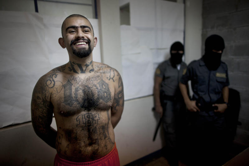 "In this Aug. 29, 2012 photo, the leader of the Guatemala branch of the M-18 gang, Aldo Dupie Ochoa Mejia, alias ""El Lobo"" or ""The Wolf,"" smiles as poses for photos inside the Frajines 1 prison in Guatemala City. Mejia says his gang is considering and willing to make a truce with their rival, the MS-13 gang, such as the one that appears to be holding in El Salvador. (AP Photo/Rodrigo Abd)"