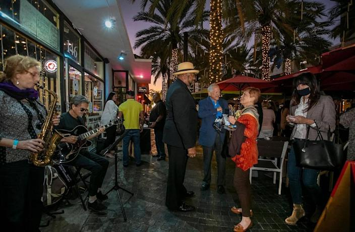 South Florida Professionals hold a networking event at Clutch Burger on Giralda Plaza.