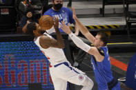 Los Angeles Clippers guard Paul George (13) loses control of the ball as he is defended by Dallas Mavericks guard Luka Doncic (77) in the first half during Game 6 of an NBA basketball first-round playoff series in Dallas, Friday, June 4, 2021. (AP Photo/Michael Ainsworth)