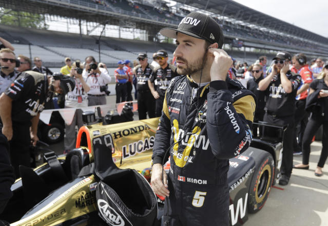 FILE - In this May 20, 2017, file photo, James Hinchcliffe, of Canada, waits for the start of qualifications for the Indianapolis 500 IndyCar auto race at Indianapolis Motor Speedway in Indianapolis. If Hinchcliffe has learned anything about Indianapolis Motor Speedway over the last eight years, its how exhilarating and cruel this track can be to drivers. (AP Photo/Darron Cummings, File)