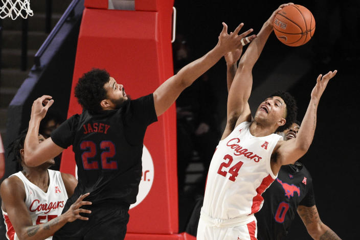 Houston guard Quentin Grimes (24) grabs a rebound from SMU forward Isiah Jasey (22) during the second half of an NCAA college basketball game, Sunday, Jan. 31, 2021, in Houston. (AP Photo/Eric Christian Smith)