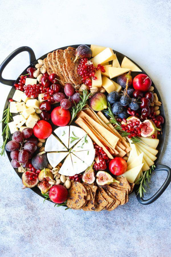 """<p>This spread is almost too stunning to eat. It features a delicious mix of finger foods including crackers, cheeses, and fruits.</p><p><strong>Get the recipe at <a href=""""https://damndelicious.net/2018/12/19/holiday-cheese-board/"""" rel=""""nofollow noopener"""" target=""""_blank"""" data-ylk=""""slk:Damn Delicious"""" class=""""link rapid-noclick-resp"""">Damn Delicious</a>.</strong> </p>"""