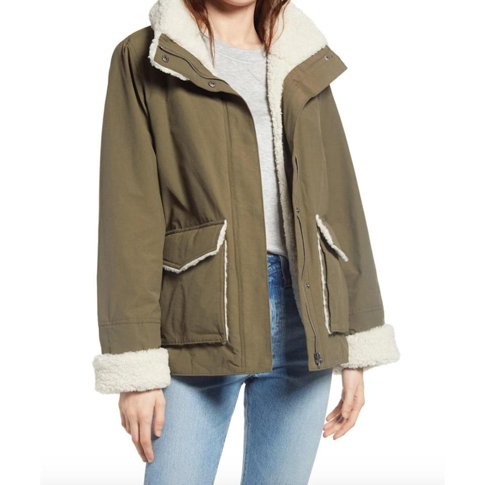 """Trade your <a href=""""https://www.glamour.com/gallery/35-chic-fall-jackets-and-light-winter-coats-shop?mbid=synd_yahoo_rss"""" rel=""""nofollow noopener"""" target=""""_blank"""" data-ylk=""""slk:lightweight jacket"""" class=""""link rapid-noclick-resp"""">lightweight jacket</a> in for a piece with a little more heft, like this shearling-lined number featuring massive pockets to store all your essentials. $79, Nordstrom. <a href=""""https://www.nordstrom.com/s/thread-supply-faux-shearling-cotton-blend-barn-jacket/5742517?"""" rel=""""nofollow noopener"""" target=""""_blank"""" data-ylk=""""slk:Get it now!"""" class=""""link rapid-noclick-resp"""">Get it now!</a>"""