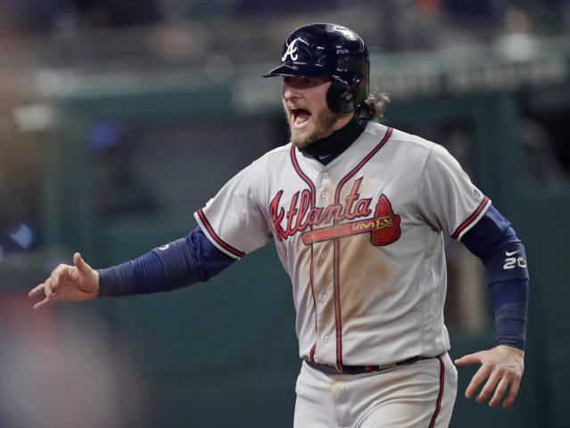 Atlanta Braves' Josh Donaldson celebrates after scoring off Ronald Acuna Jr.'s two-run double in the ninth inning during the second game of a baseball doubleheader against the Cleveland Indians, Saturday, April 20, 2019, in Cleveland. Atlanta won 8-7. (AP Photo/Tony Dejak)