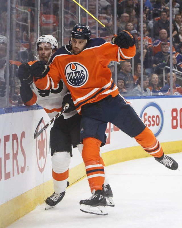 Philadelphia Flyers' Justin Braun, left, is checked by Edmonton Oilers' Zack Kassian (44) during the second period of an NHL hockey game Wednesday, Oct. 16, 2019, in Edmonton, Alberta. (Jason Franson/The Canadian Press via AP)