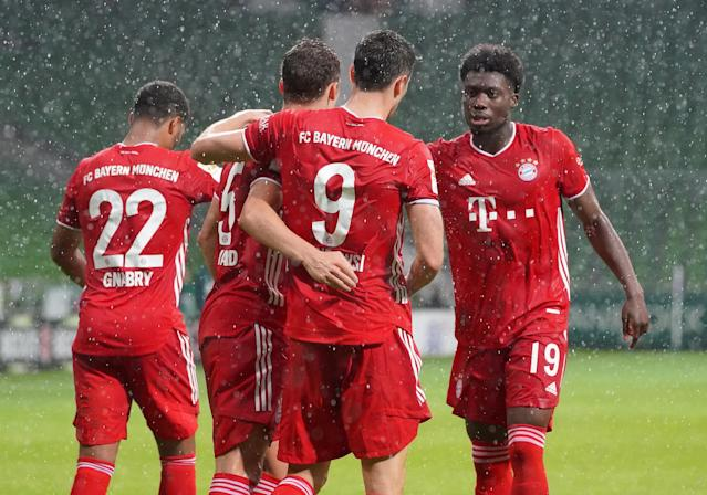 Bayern Munich players celebrate a first half goal by Robert Lewandowski (9). (M. Donato/Getty Images)